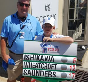 Youngster and his father after witnessing Sam Saunders' Round Two 5-under par 66!