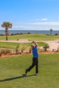 Hammock Beach Director of Golf Brad Hauer hits a ceremonial first tee shot at the re-opening of the Ocean Course at Hammock Beach Resort. The course re-opened on November 2, 2017 after a 13-month restoration. Photo Credit: Gregory