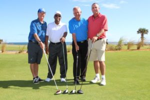 The ceremonial first foursome at the re-opening of the Ocean Course at Hammock Beach comprised (from left to right): Paul Propis, the resort's golf committee chairman; Lee Elder, the barrier-breaking, four-time PGA TOUR winner; Brad Hauer, Hammock Beach Resort's director of golf; and Tennis Hall of Famer Ivan Lendl Photo Credit: Gregory Heck