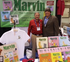 With author Harold R. Mann in the Marvin The Golf Caddy at the 2018 PGA Show.