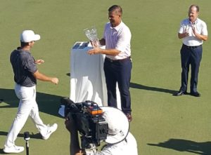 Denny McCarthy strolls up to get his trophy after winning the Tour Championship by 4 strokes!