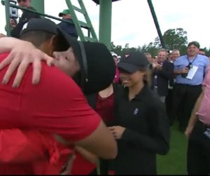 Tiger hugging lady, daughter Sam nearby and Andy in blue shirt in background! What a thrill to witness history!   Photo Credit: Unknown.