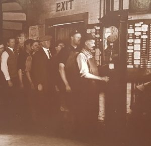 George F. Johnson in line with his workers ringing out on the Time Recording Clock Machine!